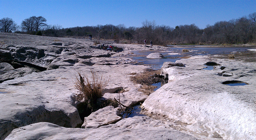 Kids playing at McKinney Falls Lower Falls
